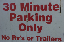 sign says 30 minute parking only, no RVs or trailers