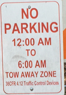 sign says no parking 12 a.m. to 6 a.m. tow-away zone
