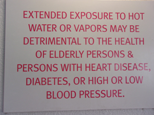 sign warning of exposure to hot water or vapors