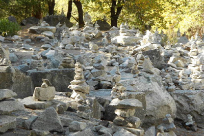 hundreds of rocks stacked along a trail