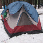 tent with end of poles sticking into snow instead of set in tent