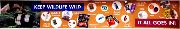 sign that says keep wildlife wild. . . it all goes in, with pictures of food, toiletries