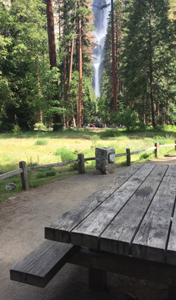 picnic table in foreground, Yosemite Falls in background
