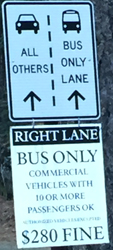 sign designating bus only lane