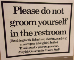 sign that says please do not groom yourself in the restroom (brushing teeth, fixing hair, shaving, applying makeup or taking bird baths)