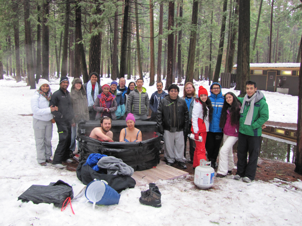 group photo in Yosemite Upper River Campground, including two people in an inflatable hot tub in the snow.