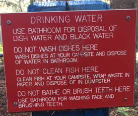 drinking water faucet sign on post