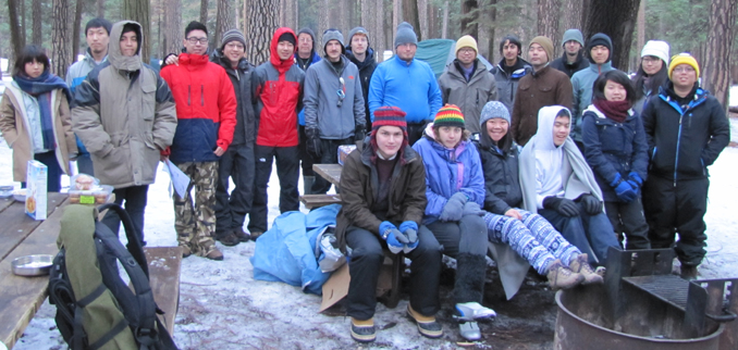 group of people in a campground in the snow