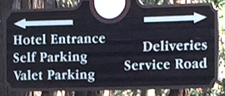 sign listing entrance, self parking, valet parking