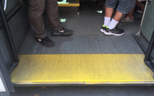 yellow painted section of bus floor