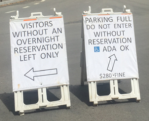 two a-frame signs in road