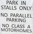 sign that says park in stalls only
