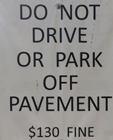 sign that says do not drive or park off pavement