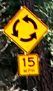 sign with counterclockwise arrows
