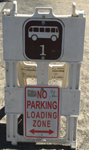sign that says no parking loading zone