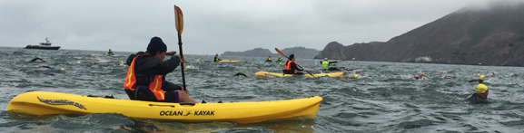swimmers, choppy water and kayakers