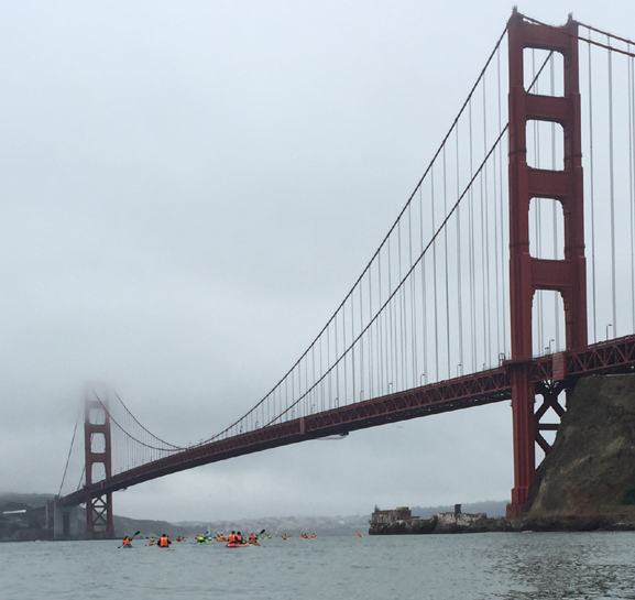 a very big Golden Gate bridge and very small looking kayakers