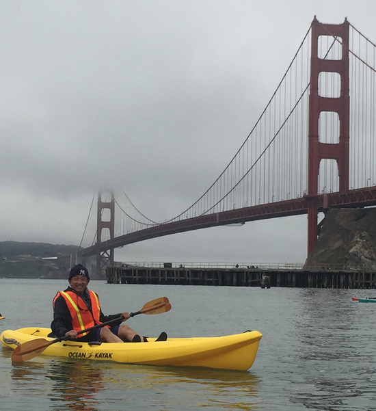 guy in kayak with Golden Gate bridge behind