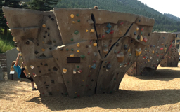 girl climbing on boulder