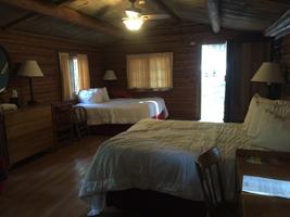 beds, ceiling fan, open doorway