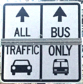 sign designating one lane for all traffic and one lane for bus only