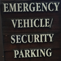 sign that says emergency vehicle security parking