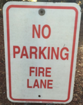 sign that says no parking, fire lane