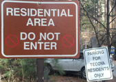 two signs that say  residential area do not enter and  parking for Tecoya residents only