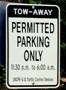 sign that says  tow-away permitted parking only, 11:30 p.m. to 6 a.m.