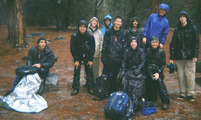 hikers in waterproof rain jackets and pants