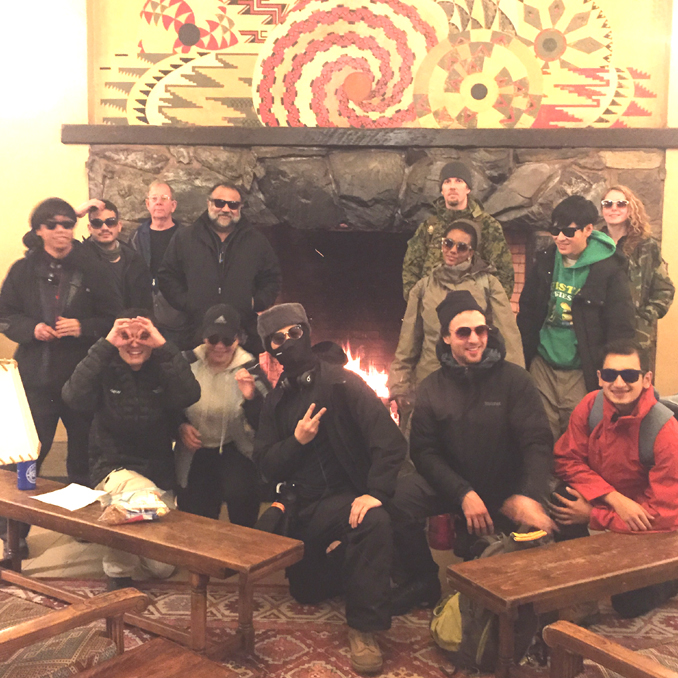 group photo in front of Ahwahnee fireplace, with sunglasses