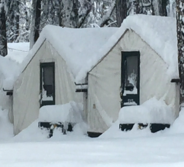 snow covered tent cabins
