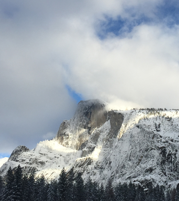 Half Dome peeking out from clouds