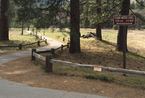 path with sign showing water depth during the 1997 Yosemite Valley flood