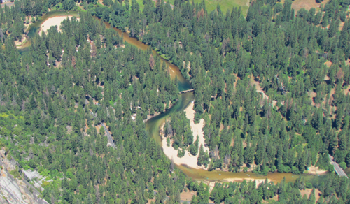 aerial photo of forest, river and 2 bridges