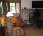 room with fireplace, large chairs