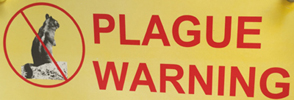 sign that says plague warning