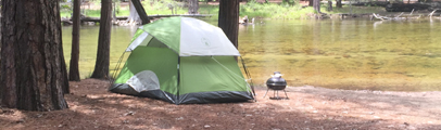tent by the river in Yosemite