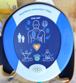 defibrillator with drawings of steps to use it