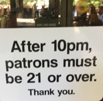 sign says: after 10pm, patrons must be 21 or over