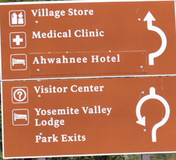 sign listing Yosemite village store, medical clinic, Ahwahnee hotel, visitor center, Yosemite Valley Lodge, park exits