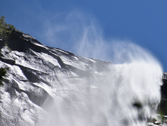 wind whipped water at top of waterfall