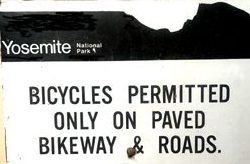 sign that says bicycles permitted only on paved bikeway and roads
