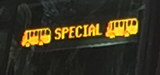 sign with two bus drawings and the word special