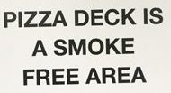 sign that says pizza deck is a smoke free area