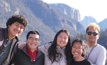 five people in foreground, El Capitian and Half Dome behind