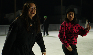 2 women ice skating