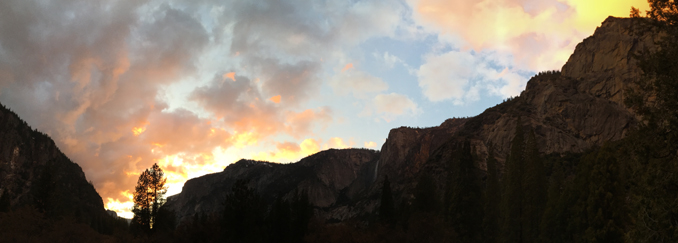 Yosemite cliff with sunset clouds