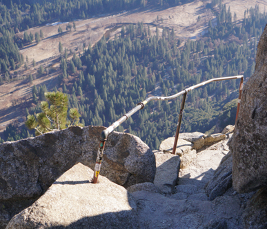 railing along trail and view to Yosemite valley below