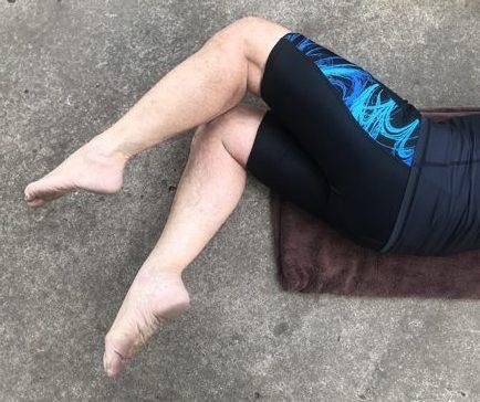 bent legs slightly apart